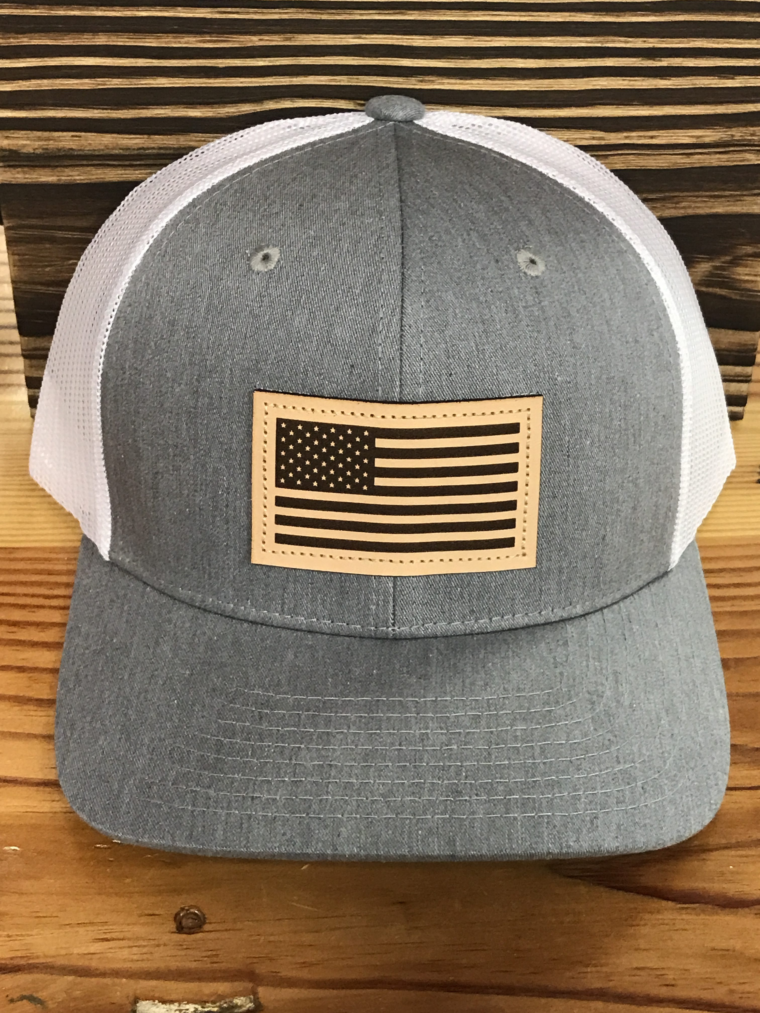 c87e81242f6 Captuer USA Flag Leather Patch Trucker Hat Heather Grey White Accessories
