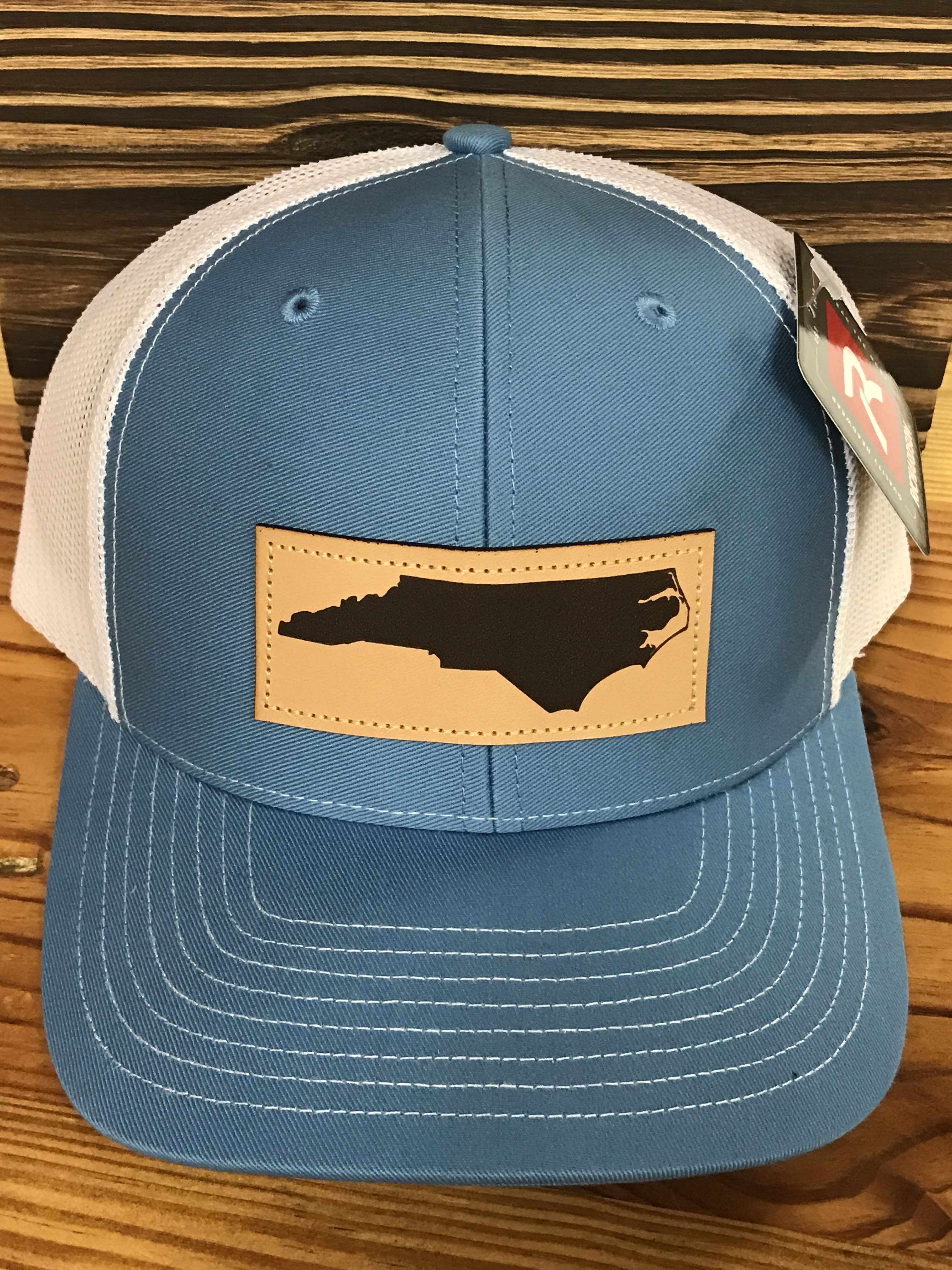 78eb6486992 North Carolina Mesh Back Leather Patch Trucker Hat Light Blue White  Accessories