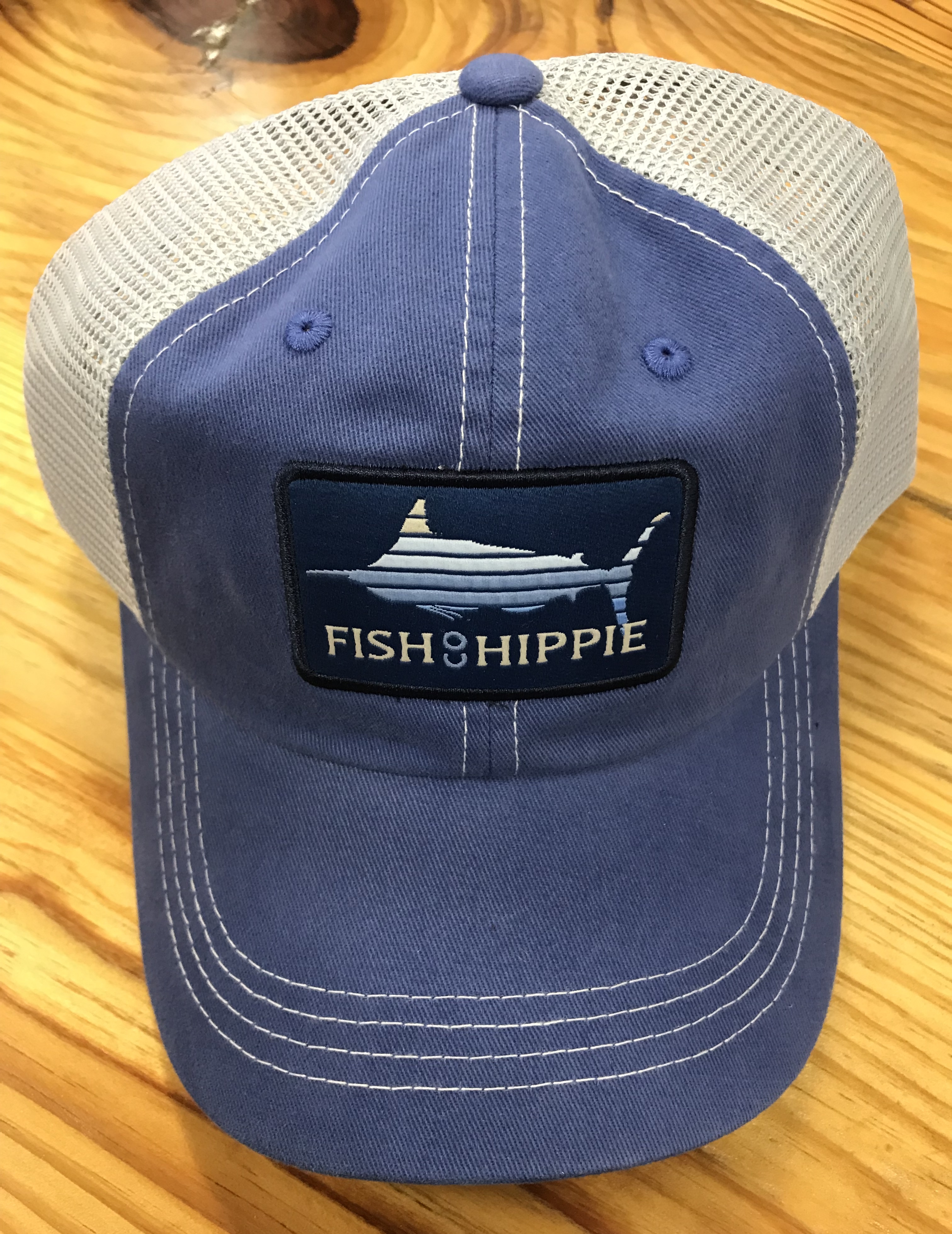 Fish hippie lines out mesh back trucker hat true blue ag for Fish hippie hats
