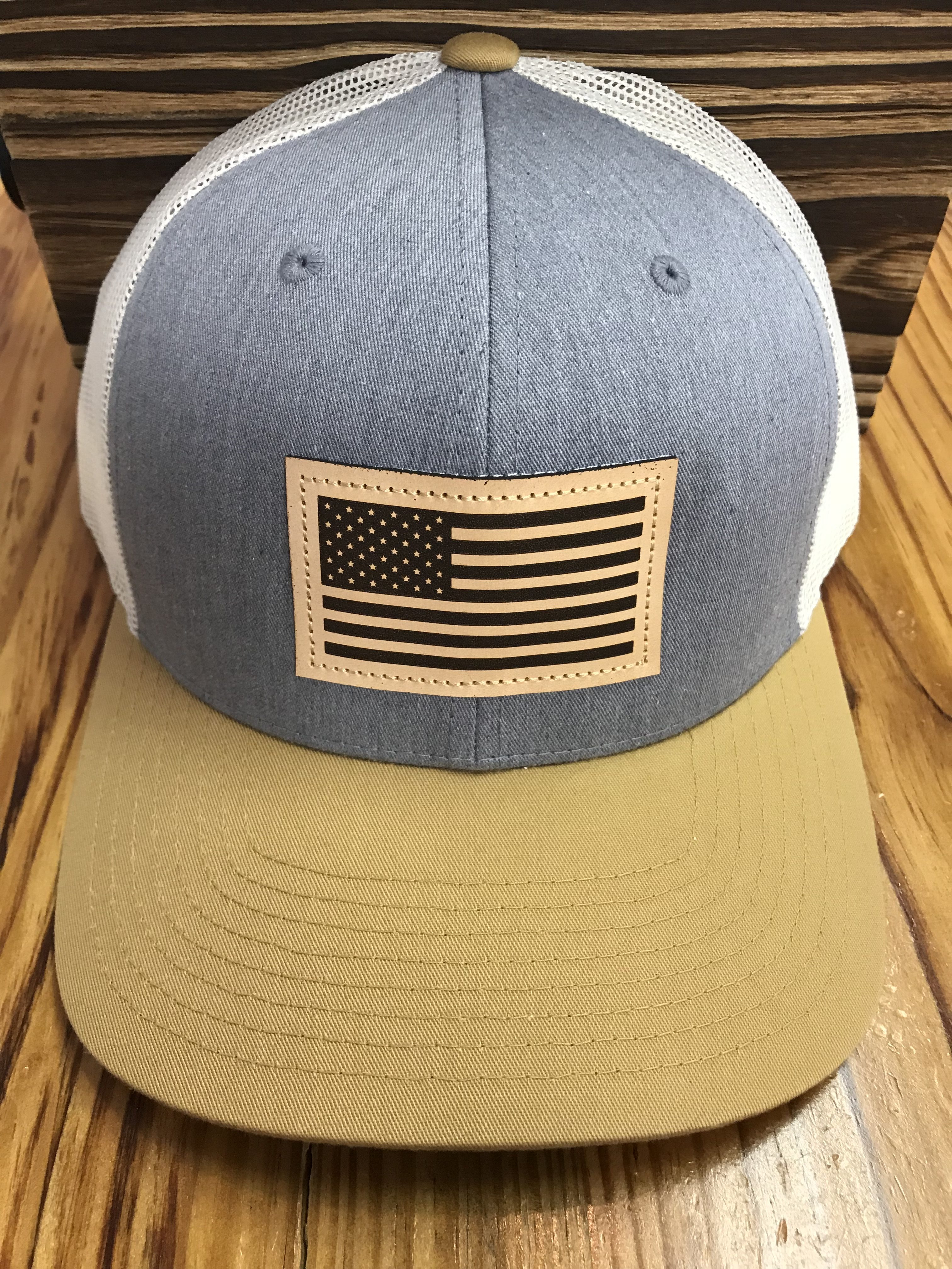 f223ce42e2d Captuer USA Flag Leather Patch Trucker Hat Heather Grey Birch Biscuit  Accessories