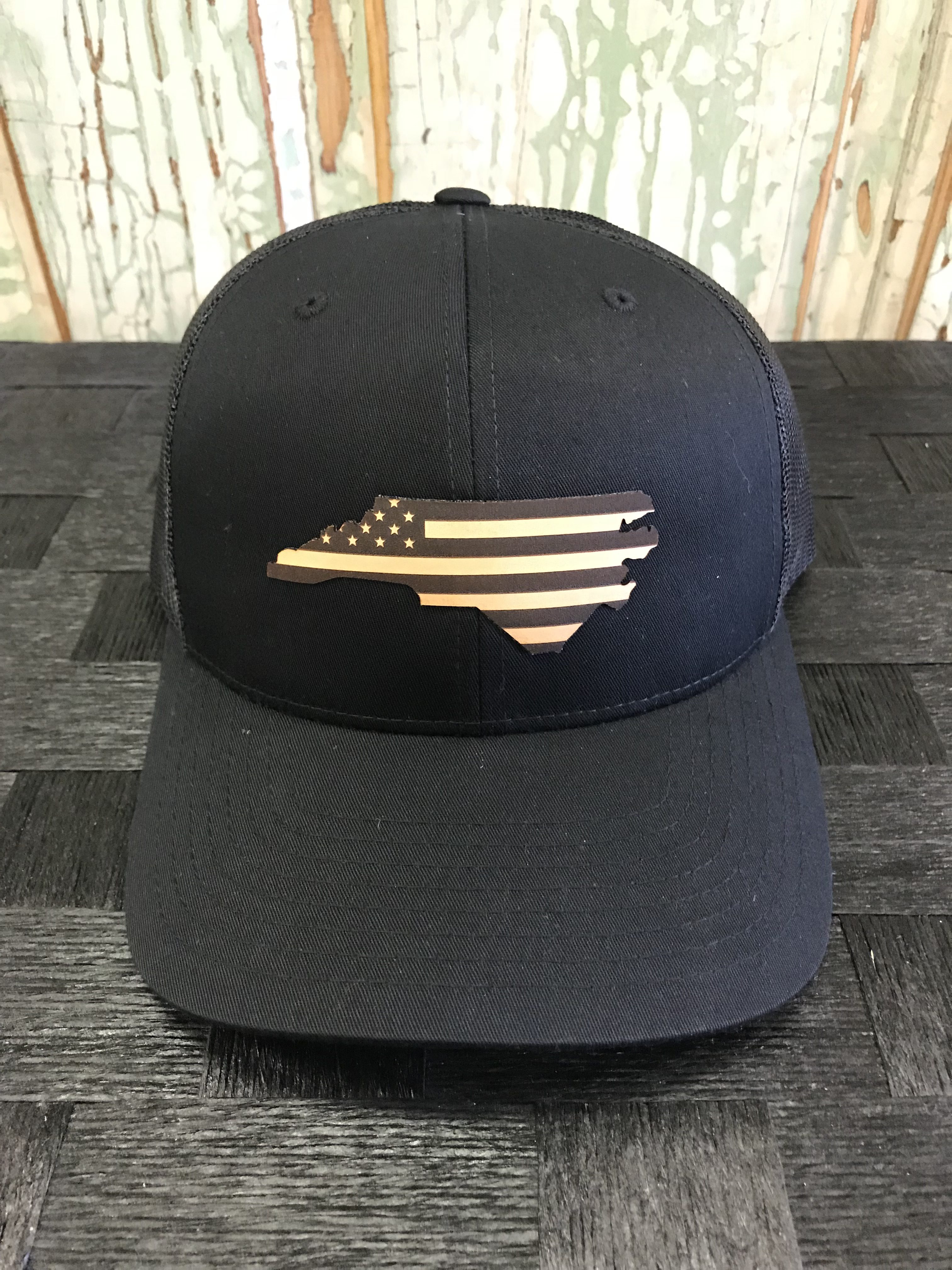 5d8e693ef06 North Carolina USA Flag Leather Patch Snapback Trucker Hat Black Black  Accessories