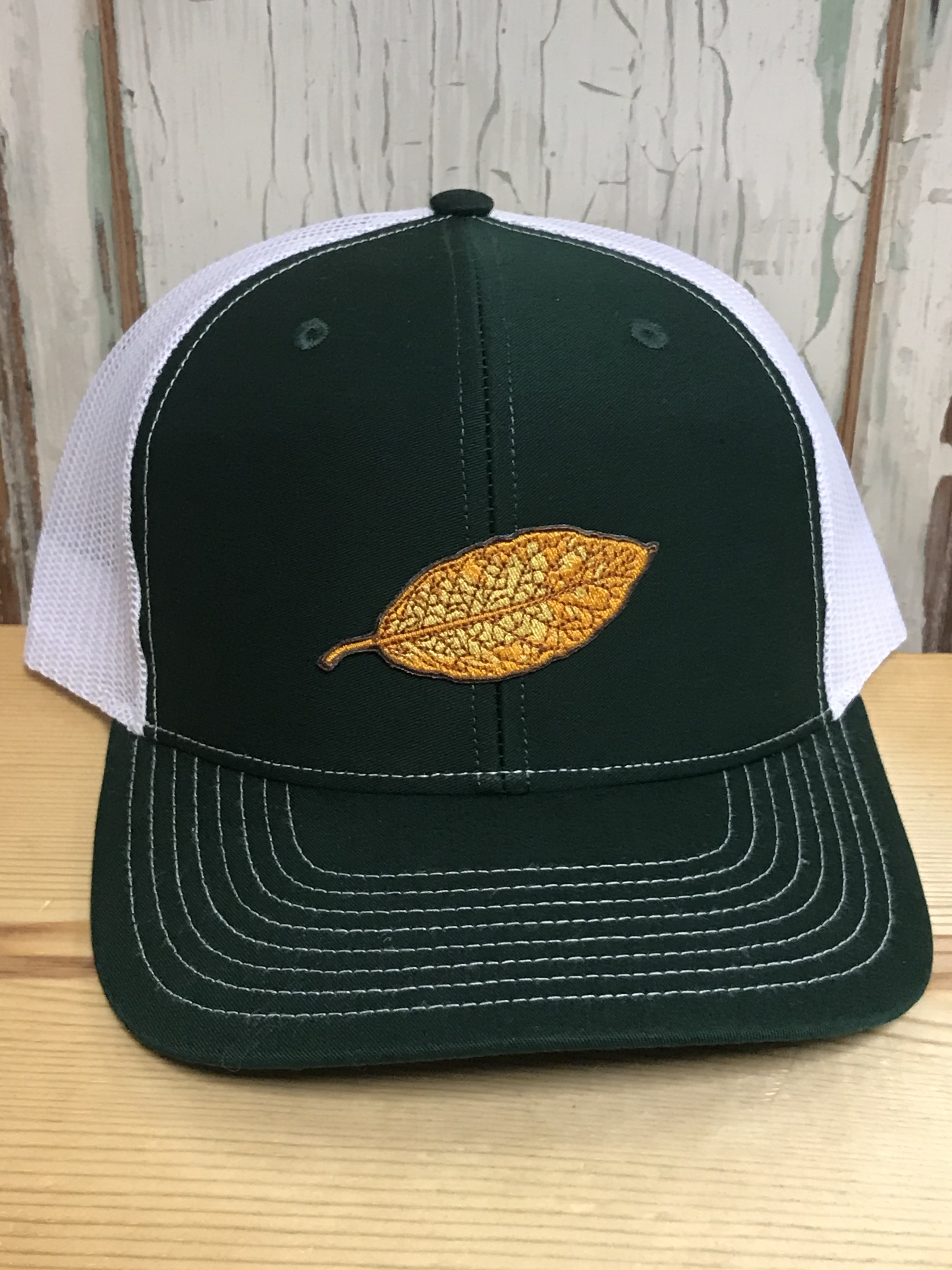 d396ea995c09f Tobacco Leaf Patch Snapback Trucker Hat Dark Green White Accessories